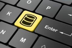 编程的概念:在键盘背景的数据库 免版税库存图片