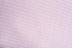 编织 镶边的桃红色编织织品纹理,被编织的样式背景 与桃红色被编织的格子花呢披肩的卧具 复制空间 平的位置, 免版税库存照片