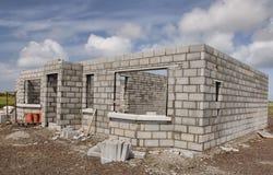 编译水泥房子新的石头 库存照片