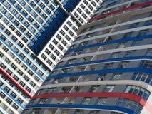 编译的多楼层 现代的结构 明亮的摩天大楼 免版税库存照片