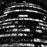 编译的现代晚上办公室摩天大楼 库存图片