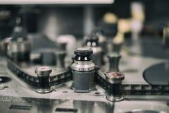 编辑35 mm电影的机器缠绕细节 库存照片