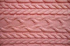 编织蓝色羊毛与缆绳样式的被编织的织品纹理  库存图片