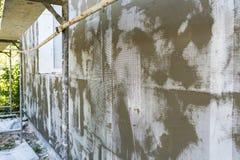 绝缘材料墙壁技术由起泡沫的,泡沫,滤网,胶浆的解答层数  免版税库存图片