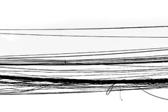 缚住被缠结的导线,高压电缆被缠结的导线摘要剪影黑色白色背景 免版税图库摄影