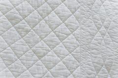 缝制的白色自然纺织品 库存照片