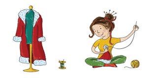 缝合圣诞老人圣诞节服装的裁缝女孩 免版税图库摄影
