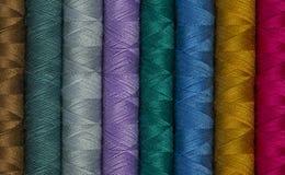 缝合针线劳斯用不同的颜色 免版税库存图片