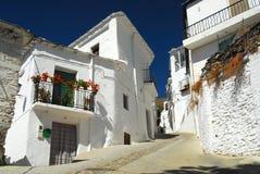 缩小的西班牙街道村庄 免版税库存图片