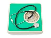 缩放比例听诊器重量 图库摄影