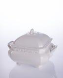 罐或陶瓷食物罐在背景 免版税库存图片