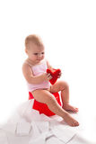 罐的婴孩有红色心脏的,白色背景 免版税图库摄影
