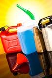 罐,汽车的液体在生动的moto概念 免版税图库摄影