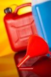 罐,汽车的液体在生动的moto概念 免版税库存照片