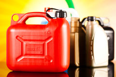罐,汽车的液体在生动的moto概念 免版税库存图片