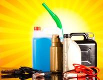 罐,汽车的液体在生动的moto概念 图库摄影