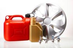 罐,汽车的液体在生动的moto概念 库存照片