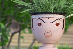 罐,泰国神面具  库存照片