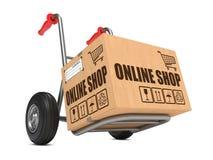 网上商店-纸板箱在手边卡车。 免版税库存照片