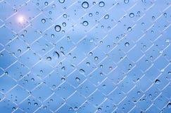 网格图形天空雨下落和阳光 免版税库存图片