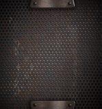 网格钻孔了被穿孔的金属 库存图片