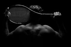 网球员和他的球拍 免版税库存图片