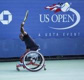 网球员从南非的卢卡斯Sithole在美国公开赛2013年轮椅方形字体期间选拔比赛 免版税库存照片