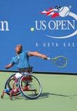网球员从南非的卢卡斯Sithole在美国公开赛2014年轮椅方形字体期间选拔比赛 图库摄影