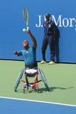 网球员从南非的卢卡斯Sithole在美国公开赛2014年轮椅方形字体期间选拔比赛 库存图片