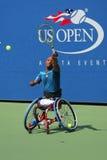 网球员从南非的卢卡斯Sithole在美国公开赛2014年轮椅方形字体期间选拔比赛 免版税图库摄影