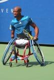 网球员从南非的卢卡斯Sithole在美国公开赛2014年轮椅方形字体期间选拔比赛 免版税库存照片