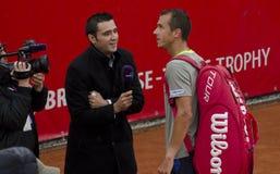 网球比赛-吉尔・西蒙对卢克斯Rosol 免版税库存照片