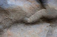 网眼图案石头和沙子纹理或者背景在墙壁上 图库摄影
