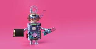 网络安全数据存储概念 系统管理员机器人玩具用usb闪光棍子和在红色背景的存储卡 免版税图库摄影