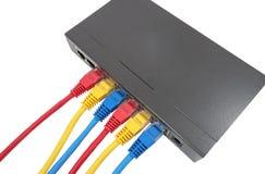 网络缆绳被连接到路由器 免版税图库摄影