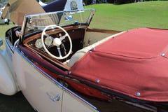 罕见的古色古香的奥地利汽车客舱 免版税库存图片