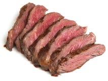 罕见的牛肉,在白色背景切的里脊肉牛排 免版税库存照片