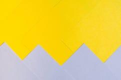 紫罗兰色和黄色纸背景 库存照片