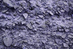 紫罗兰色石墙纹理 图库摄影