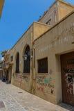 罗希姆诺,希腊- 2016年8月5日:Na的被放弃的大厦 免版税库存图片