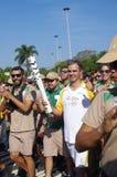 罗德里戈佩索阿和Rio2016奥林匹克火炬 免版税图库摄影