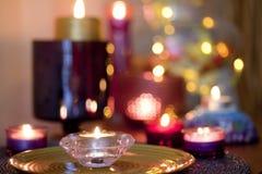 罗斯蜡烛有五颜六色的背景 库存图片