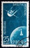罗马尼亚大约1958年与卫星和地球行星 免版税图库摄影