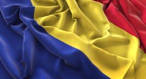 罗马尼亚旗子被翻动的美妙地挥动的宏观特写镜头射击 库存图片
