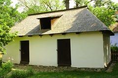 罗马尼亚语涂灰泥的白话房子 库存图片