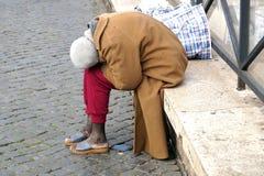 罗马意大利2015年11月15日:无家可归的人,象被生动描述的一个 图库摄影