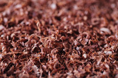 罚款被磨碎的巧克力背景 免版税图库摄影