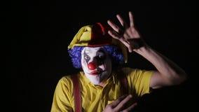 罪恶,恐怖调查照相机的小丑人 股票视频