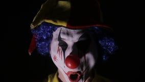 罪恶,恐怖调查照相机的小丑人 股票录像