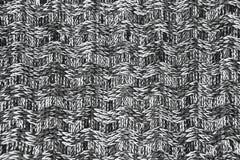 羊毛围巾或毛线衣纹理关闭 红色被编织的球衣backg 免版税图库摄影